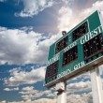 HIgh School Score Board on Cloudy Sky — Stock Photo