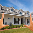 Stock Photo: Hands Framing Beautiful New House