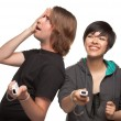 Diverse Couple with Video Game Controllers Having Fun Isolated on White — Stok fotoğraf