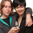 Diverse Couple Using Cell Phone Isolated on a White Background. — Stock Photo