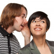 Attractive Diverse Couple Whispering Secrets Isolated on a White Background — 图库照片