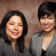 Brunette Multiethnic Mother and Daughter Studio Portrait on a Muslin Back — Stock Photo