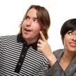 Diverse Caucasian Male and Multiethnic Female Pointing and Looking Up and O — Foto de Stock