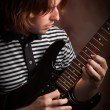 Young Musician Plays His Electric Guitar with Dramatic Lighting. — Stock Photo
