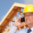 Male Contractor in Hardhat at Construction Site Talks on Cell Phone. — Zdjęcie stockowe