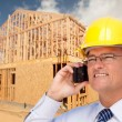Construction Contractor in Hardhat Talks on His Cell Phone. — Стоковая фотография