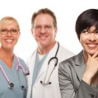 Multiethnic Teen and Two Doctors Isolated on a White Background. — Stock Photo