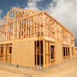 Abstract of New Home Construction Site Framing. - Foto de Stock