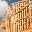 Stock Photo: Abstract of New Home Construction Site Framing.