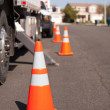 Several Orange Hazard Cones and Utility Truck in Street. — Stock Photo #3289982