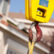 Yellow Utility Industrial Crane Head with Red Hook. - Stok fotoğraf