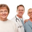 Smiling Senior Woman with Medical Doctor and Nurse Behind Isolated on a Whi — Stock Photo