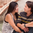 Attractive Hispanic Couple Portrait Enjoying Each Other Outdoors. - Stock Photo