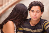 Attractive Hispanic Couple During A Serious Moment at a Fountain. — Stock Photo