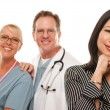 Hispanic Woman with Male Doctor and Nurse — Foto Stock