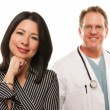 Hispanic Woman with Male Doctor or Nurse - Stockfoto