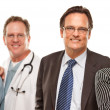 Stock Photo: Hispanic Woman with Husband and Male Doctors or Nurses