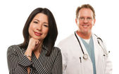 Hispanic Woman with Male Doctor or Nurse — Stock Photo