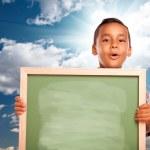 Proud Hispanic Boy Holding Blank Chalkboard Over Sky — Stock Photo