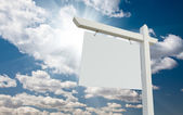 Blank Real Estate Sign over Clouds and Blue Sky — Stock Photo