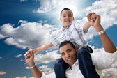 Hispanic Father and Son Having Fun Over Clouds — Stock Photo