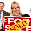 Man with Blonde Woman Holding Keys and Sold For Sale Sign — Foto de Stock