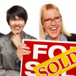 Real Estate Team with Woman Holding Keys and Sold For Sale Sign — Stockfoto