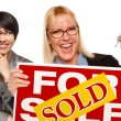Female with Blonde Woman Holding Keys and Sold For Sale Sign — Foto de Stock