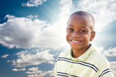 Young African American Boy with Clouds and Sky — Stock Photo