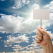 Man Holding Blank Sign Over Clouds and Sky — Stock Photo #3490080