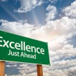 Excellence Green Road Sign Over Clouds — Stock Photo