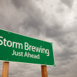 Storm Brewing Green Road Sign Over Storm Clouds — Stock Photo