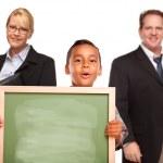 Hispanic Boy Holding Chalk Board with Teachers Behind — Stock Photo