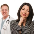 Hispanic Woman with Male and Female Doctor or Nurse — Stock Photo