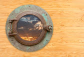 Antique Porthole with View of Sunset on Bamboo Wall — Stock Photo