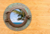 Antique Porthole with Tropical Beach View on Bamboo Wall — Stock Photo