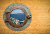 Antique Porthole on Bamboo Wall with View of Ship Deck Railing a — Stock Photo