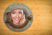 Antique Porthole on Bamboo Wall, Woman with Thumbs Up Looking — Stock Photo