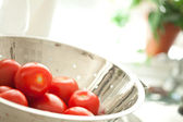 Fresh, Vibrant Roma Tomatoes in Colander with Water Drops — Stock Photo