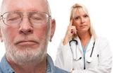 Concerned Senior Man and Female Doctor Behind — Stock Photo