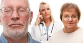 Concerned Senior Couple and Female Doctor Behind — Stock Photo