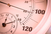 Colorized Round Thermometer Showing Over 100 Degrees — Stock Photo