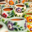 Variety of Colorfully Painted Ceramic Pots. - Stock Photo