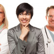 Young Multiethnic Woman with Doctors and Nurses Behind — Stock Photo