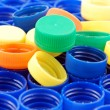 Rows of blue and colorful plastic lids - Stockfoto