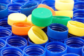 Rows of blue and colorful plastic lids — Stock Photo