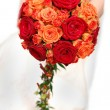 Bride holding orange bouquet - Stock Photo