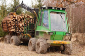 Tree log hydraulic manipulator - tractor — Stock Photo
