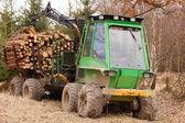 Tree log hydraulic manipulator - tractor — Stock Photo