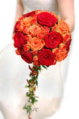 Bride holding orange bouquet — Stock Photo
